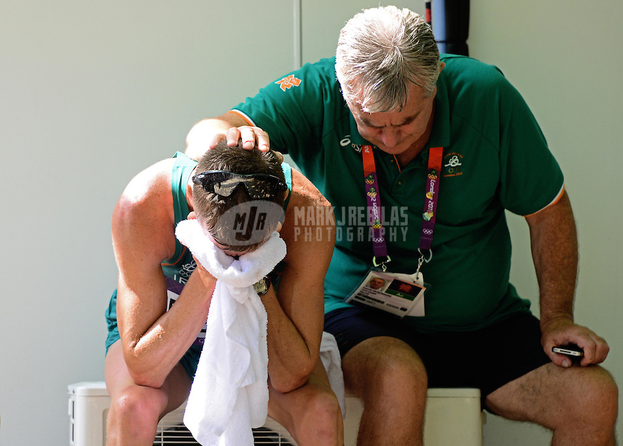 Aug 11, 2012; London , United Kingdom; Robert Heffernan (IRL), left, cries as he is consoled by his coach after finishing fourth during the men's 50km race walk in the London 2012 Olympic Games at The Mall. Mandatory Credit: Mark J. Rebilas-USA TODAY Sports
