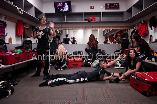 Miami, Florida<br /> January 29, 2012<br /> <br /> Miami Heat Dancers apply make-up and listen to spiritual advise in the dressing room just minutes before the game between the Chicago BULLS and the Miami HEAT.