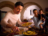 A young family make authentic Tortellini in a beautiful Italian kitchen.