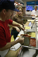 Mercedes Lockwood helps her grandfather Rich Lockwood serve up spaghetti as the Lions Club hosts 14th annual spaghetti dinner to benefit the Dana Foundation of Dana Middle School, Sunset Cliffs Surfing Association Spinal Chord Injuries and the Guide Dogs of the Desert, Saturday, February 2, 2008.