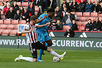 Richard Stearman of Sheffield United gets in a last gasp tackle on Shaquile Coulthirst of Barnet during Sheffield United vs Barnet, Emirates FA Cup Football at Bramall Lane on 6th January 2019
