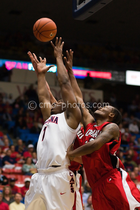 Nov 6, 2008; Tucson, AZ, USA; Arizona Wildcats forward Fendi Onobun (1) goes up for an offensive rebound in front of two Incarnate Word Cardinals in the second half of a game at the McKale Center.  Arizona won the game 97-83.