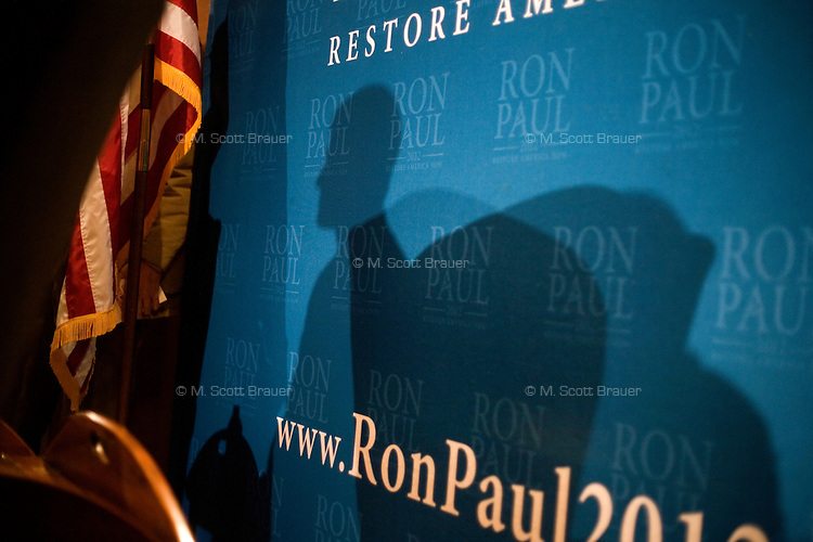 People listen to congressman Ron Paul speak at a town hall meeting and rally at the Church Landing at Mills Falls hotel in Meredith, New Hampshire, on Jan. 8, 2012. Paul is seeking the 2012 Republican presidential nomination.
