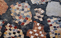 Detail of fragments of Punic mosaic in the Mago Quarter, Carthage, Tunisia, pictured on January 27, 2008, in the afternoon. Carthage was founded in 814 BC by the Phoenicians who fought three Punic Wars against the Romans over this immensely important Mediterranean harbour. The Romans finally conquered the city in 146 BC. Subsequently it was conquered by the Vandals and the Byzantine Empire. Today the site is a UNESCO World Heritage. Fine Punic craftwork is preserved in Houses and Villas in the Mago Quarter. Picture by Manuel Cohen.