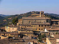 Rooftop view of the Umbrian hilltown of Montone Italy and Gothic church of S. Francisc