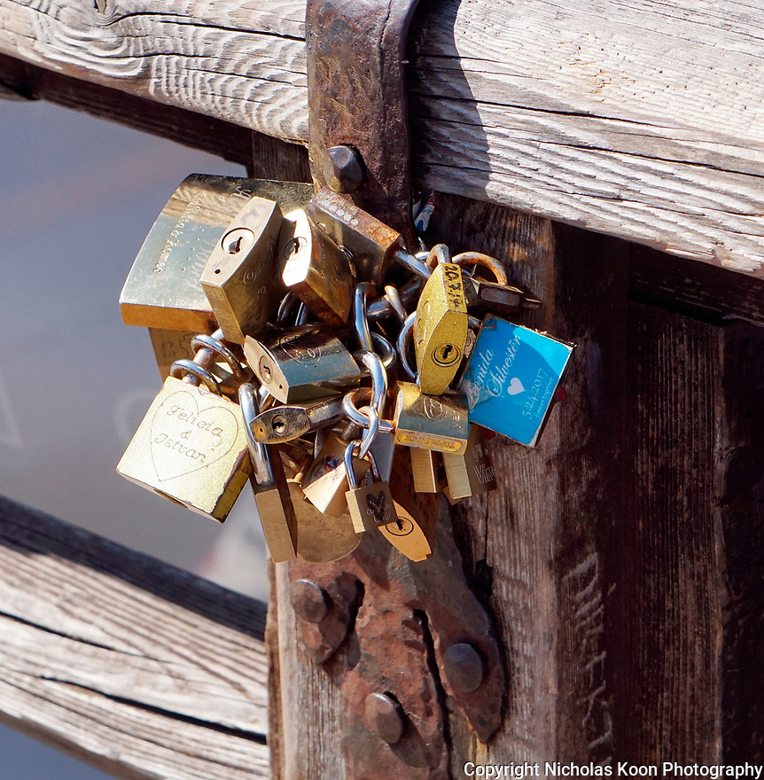 Locks dedicated to couples are familiar sight on many bridges across Italy.  In fact, there are people there selling them to assist you in participating in this romantic gesture.