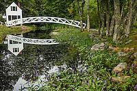 Somesville, Mount Desert Island, Maine: Selectmen's building (1870) and Thaddeus Somes Memorial bridge reflecting in summer pond.
