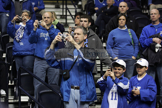 Fans take pictures of the team warming up before the UK mens basketball team's 73-67 win over Alabama in the quarterfinals of the SEC tournament at the Sommet Center Friday, March 12, 2010. Photo by Britney McIntosh | Staff