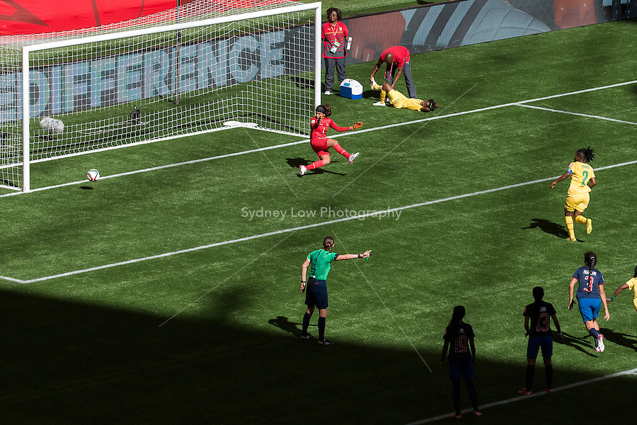 June 8, 2015: Christine MANIE of Cameroon kicks and scores from a penalty during a Group C match at the FIFA Women's World Cup Canada 2015 between Cameroon and Ecuador at BC Place Stadium on 8 June 2015 in Vancouver, Canada. Sydney Low/AsteriskImages