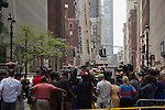 NEW YORK - MAY 31: Pedestrians, Police and Fire Department gather after an AC Unit Falls From Crane in Midtown Manhattan