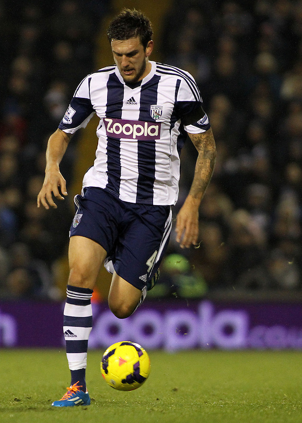 West Bromwich Albion's Goran Popov in action during todays match.<br /> <br /> Photo by James Marsh/CameraSport<br /> <br /> Football - Barclays Premiership - West Bromwich Albion v Aston Villa - Monday 25th November 2013 - The Hawthorns - West Bromwich<br /> <br /> &copy; CameraSport - 43 Linden Ave. Countesthorpe. Leicester. England. LE8 5PG - Tel: +44 (0) 116 277 4147 - admin@camerasport.com - www.camerasport.com