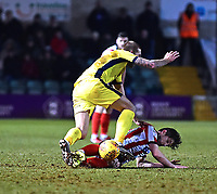 Lincoln City's Alex Woodyard vies for possession with Cheltenham Town's Harry Pell<br /> <br /> Photographer Andrew Vaughan/CameraSport<br /> <br /> The EFL Sky Bet League Two - Lincoln City v Cheltenham Town - Tuesday 13th February 2018 - Sincil Bank - Lincoln<br /> <br /> World Copyright &copy; 2018 CameraSport. All rights reserved. 43 Linden Ave. Countesthorpe. Leicester. England. LE8 5PG - Tel: +44 (0) 116 277 4147 - admin@camerasport.com - www.camerasport.com