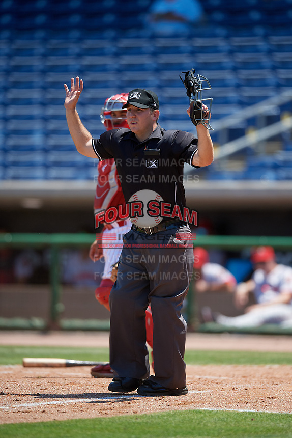 Umpire Louie Krupa calls a ball foul during a Florida State League game between the Florida Fire Frogs and Clearwater Threshers on April 24, 2019 at Spectrum Field in Clearwater, Florida.  Clearwater defeated Florida 13-1.  (Mike Janes/Four Seam Images)