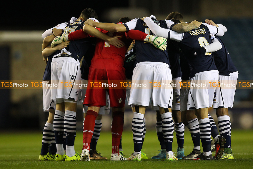 Millwall players huddle ahead of the kick-off during Millwall vs Oxford United at The Den