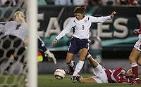 06 November,  2004.  USWNT forward Mia Hamm (9) makes her way past Bettina Falk (5) of Denmark at  Lincoln Financial Field in Philadelphia, Pa.