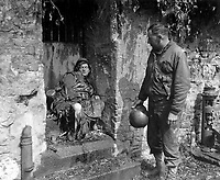 "This dead German soldier was one of the ""last stand"" defenders of German-held Cherbourg.  Capt. Earl Topley, who led one of the first outfits into the fallen city, blamed him for killing three of his boys.  France, June 27, 1944.  Zwick.  (Army)<br /> NARA FILE #:  111-SC-193970<br /> WAR & CONFLICT BOOK #:  1050"