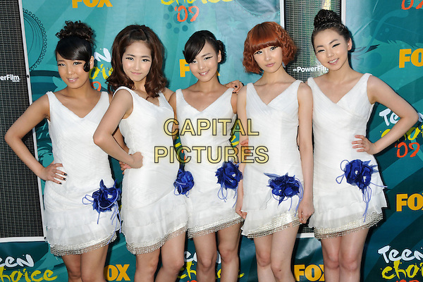 WONDER GIRLS .Teen Choice Awards 2009 - Arrivals held at the Gibson Amphitheatre, Universal City, CA, USA..August 9th, 2009.half length white dress blue corsage hand on hip .CAP/ADM/BP.©Byron Purvis/AdMedia/Capital Pictures.