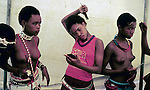 NONGOMA, SOUTH AFRICA - SEPTEMBER 11: Unidentified maidens dress and put on makeup to prepare for the annual Reed Dance on September 11, 2004 in Nongoma in rural Natal, South Africa. About 20.000 fellow maidens from all over South Africa has arrived to dance for Zulu King Goodwill Zwelethini at the Enyokeni Royal Palace in Kwa-Nongoma about 350 kilometers from Durban. The girls come to the kingdom to declare their virginity and the ceremony encourages girls and young women to abstain from sexual activity to curb the spread of HIV-Aids. Its Nobuhle's first trip and she's already has three virginity certificates as she was tested in the village for the last three years. .(Photo: Per-Anders Pettersson).....