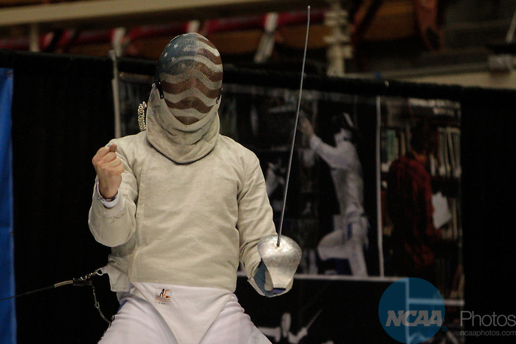 20 MAR 2015:  Andrew Mackiewicz, of Penn State, celebrates winning against Ferenc Valkai, of St. John's, in the sabre event finals during the Division I Men's Fencing Championship held at St. John Arena on the Ohio State University campus in Columbus, OH. Mackiewicz won the championship by a score of 15-10. Jay LaPrete/NCAA Photos
