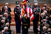 Members of the Honor Guard carry the flag-draped casket of former President George H.W. Bush out during his State Funeral at the National Cathedral, Wednesday, Dec. 5, 2018, in Washington. <br /> Credit: Andrew Harnik / Pool via CNP