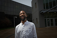 UAA Political Science Senior Demry Mebane has his portrait taken outside the UAA Consortium Library.