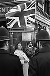 National Front supporters sell the Natioal Front News, every Sunday morning at the junction of Brick Lane and Bethnal Green Road. London 1970s. There was a regular stand off, with police and Socialist Workers Party members selling their weekly newspaper...