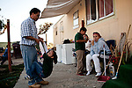 Lino, left, and Lilia Parra play relax with family at their home in the Rancho Garcia trailer park in Thermal, Calif., March 9, 2012.