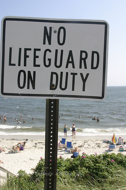 """No Lifeguard On Duty"" sign at beach."
