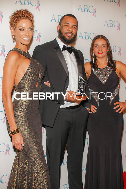 BEVERLY HILLS, CA, USA - NOVEMBER 22: Nicole Murphy, The Game, Lisa Brunson arrive at the Associates For Breast And Prostate Cancer Studios 25th Annual Talk Of The Town Black Tie Gala held at The Beverly Hilton Hotel on November 22, 2014 in Beverly Hills, California, United States. (Photo by Rudy Torres/Celebrity Monitor)