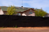 homes of polygamists behind walls and fences in colorado city / hildale