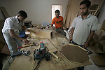 Palestinian students Deafs attend  lesson of crafts at The School el-Amal Rehabilitation of Deafs, at Rafah town in the southern Gaza Strip on October 21, 2009. The school for Deaf that was established in 1991 with the sponsorship of by the Agency France for Development, teach some 160 students Deafs in the school, faces the threat of closure because of the longstanding Israeli blockade on the Gaza Strip. Photo by Abed Rahim Khatib