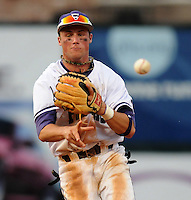 Second baseman Will Muzika (2) of the Furman Paladins grabs a slow-rolling grounder and makes the play at first in a game against the Clemson Tigers on Tuesday, May 10, 2011, at Fluor Field in Greenville, S.C. Muzika is from Dorman High School in Spartanburg. Photo by Tom Priddy / Four Seam Images