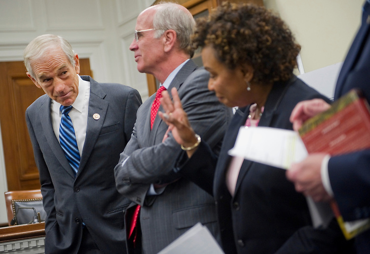 "UNITED STATES - SEPTEMBER 20: Rep. Ron Paul, R-Tex., greets  Rep. Peter Welch, D-Vt. ;  Rep. Barbara Lee, D-Calif.; and Rep. Walter Jones, R-N.C., at a news conference calling for expedited withdrawal of U.S. troops from Afghanistan and stop ""the wasteful spending."" (Photo by Chris Maddaloni/CQ Roll Call)"