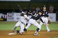 Daniel Mendick (22) of the Kannapolis Intimidators looks to the umpire for the call after applying a tag on Gerrion Grim (18) of the Delmarva Shorebirds at Kannapolis Intimidators Stadium on April 23, 2016 in Kannapolis, North Carolina.  The Shorebirds defeated the Intimidators 4-2.  (Brian Westerholt/Four Seam Images)