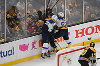 June 6, 2019: Boston Bruins defenseman Brandon Carlo (25) is checked by St. Louis Blues left wing Zach Sanford (12) and left wing David Perron (57) during game 5 of the NHL Stanley Cup Finals between the St Louis Blues and the Boston Bruins held at TD Garden, in Boston, Mass. The Blues defeat the Bruins 2-1 in regulation time. Eric Canha/CSM
