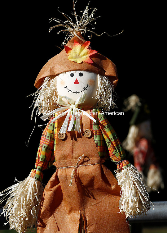 Oxford, CT- 22 September 2014-092214CM05- A scarecrow greets visitors at the Oxford Town Hall. Tuesday marks the first day of Fall, with businesses and homes already displaying flowers and other fall adornments.   Christopher Massa Republican-American