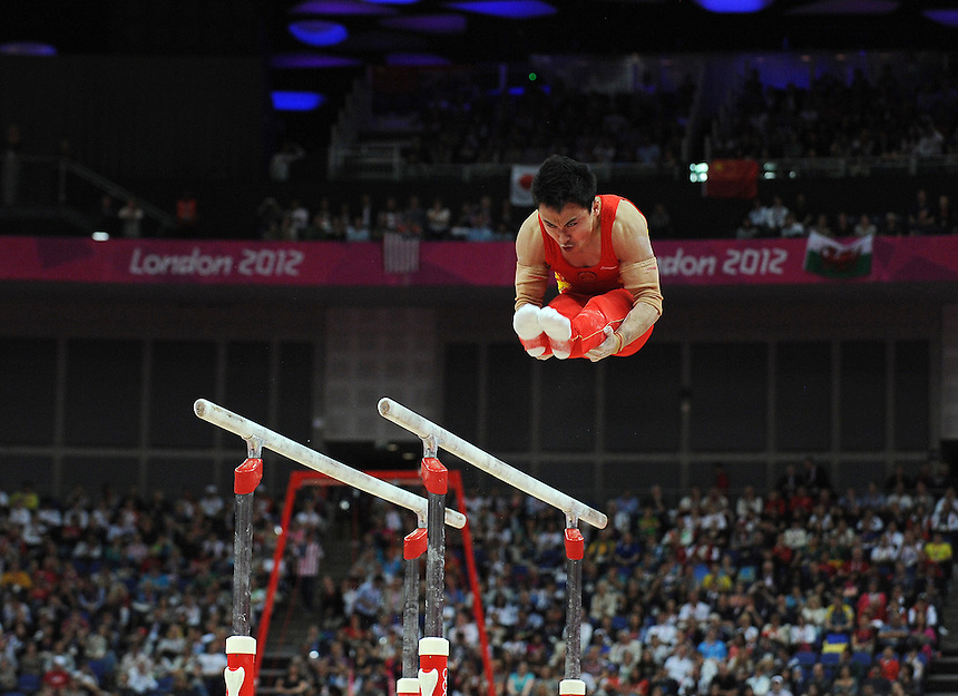 China's Zhe Feng doing his routine on the Parallel Bars <br /> 2012 London Olympics - Swimming - Monday 30th July 2012 - Aquatics Centre - London<br /> <br /> &copy; CameraSport - 43 Linden Ave. Countesthorpe. Leicester. England. LE8 5PG - Tel: +44 (0) 116 277 4147 - admin@camerasport.com - www.camerasport.com