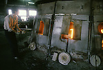 An artisan works near the factory's blast furnances at the Hokuyo Glass Manufacturing Company's  Blown Glass Factory in Aomori, Japan. Glass blowers at the factory churn out between 1,500 and 2,000 pieces of glass daily. (Jim Bryant Photo)....