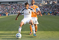 LA Galaxy defender Sean Franklin (28) defending against Houston Dynamo midfielder Cory Ashe (26). The LA Galaxy defeated the Houston Dynamo 4-1 at Home Depot Center stadium in Carson, California on Saturday evening June 5, 2010..