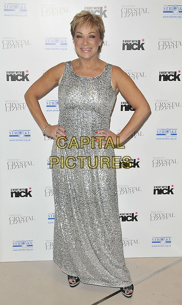 "Denise Welch.The ""A Night With Nick"" charity event in aid of The Stroke Association, Swarovski CRYSTALLIZED, Gt. Marlborough St., London, England..December 6th, 2011.full length silver sleeveless beads beaded sequins sequined dress hands on hips .CAP/CAN.©Can Nguyen/Capital Pictures."