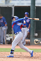 Albert Almora of the Chicago Cubs bats during a Minor League Spring Training Game against the Los Angeles Angels at the Los Angeles Angels Spring Training Complex on March 23, 2014 in Tempe, Arizona. (Larry Goren/Four Seam Images)