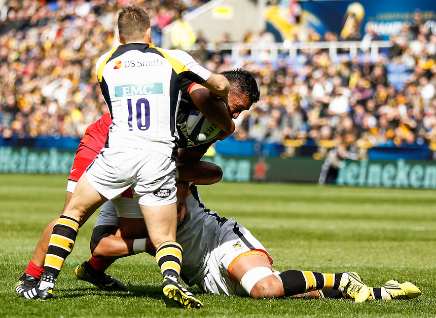 Saracens' Mako Vunipola under pressure from Wasps' Nathan Hughes and Jimmy Gopperth<br /> <br /> Photographer Simon King/CameraSport<br /> <br /> Rugby Union - European Rugby Champions Cup Semi Final - Saracens v Wasps - Saturday 23rd April 2016 - Madejski Stadium - Reading<br /> <br /> &copy; CameraSport - 43 Linden Ave. Countesthorpe. Leicester. England. LE8 5PG - Tel: +44 (0) 116 277 4147 - admin@camerasport.com - www.camerasport.com