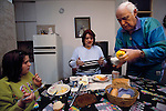 Lokman Demirovic serves his daughter and granddaughter breakfast. From coverage of revisit to Material World Project family in Sarajevo, Bosnia & Herzegovina, 2001. ©2005 Hungry Planet: What the World Eats}}.