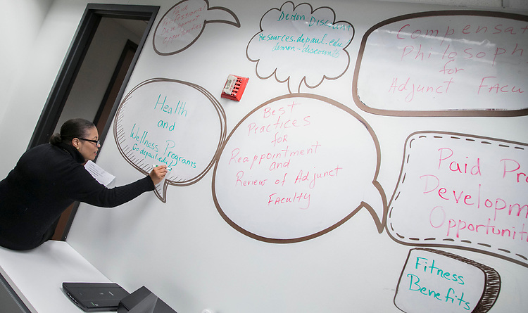 Workplace Environment Committee member Nadia André fills in a thought balloon during a networking reception for adjunct faculty members and Career Center staff, Monday, March 5, 2018, in the center's Loop Campus office. The gathering, hosted by the Workplace Environment Committee (WEC), offered participants the opportunity to meet fellow adjunct faculty members and learn about the many resources available through the Career Center.(DePaul University/Jamie Moncrief)