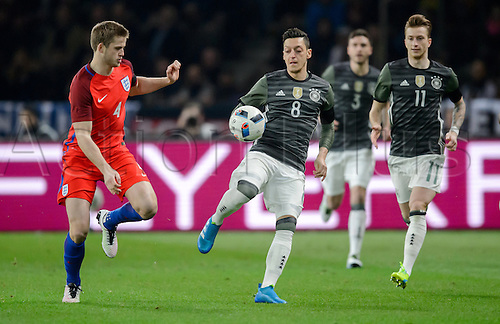 26.03.2016. Olympiastadion Berlin, Berlin, Germany.  Germany's Mesut Oezil (C) in action against England's Eric Dier (L)�during the international friendly soccer match between Germany and England at the Olympiastadion