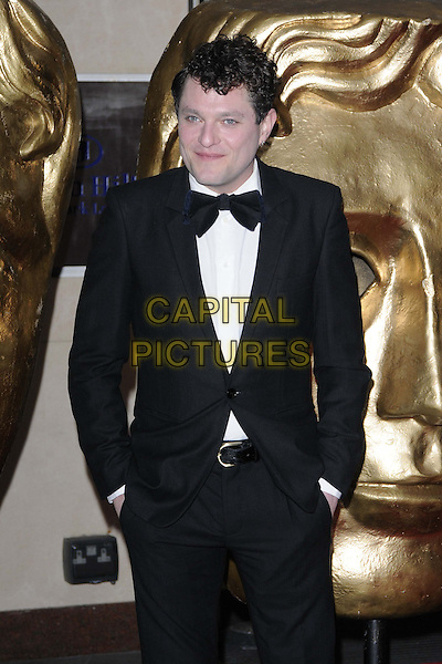 Mathew Horne.attended the British Academy ( BAFTA ) Video Game Awards, London Hilton Park Lane Hotel, London, England..March 5th, 2013.half length mat black tuxedo bow tie white shirt hands in pockets .CAP/CAN.©Can Nguyen/Capital Pictures.