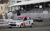 Nissan Micra Cup race, car number 24 driven by Mark Hacking