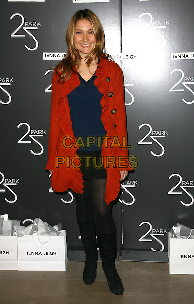 SPENSER GRAMMER .Lingerie designer Jenna Leigh and 25 Park's Alison Brettschneider unveil an intimate trunk show, New York, NY, USA..February 3rd, 2011.full length black tights coat blue top red coat.CAP/ADM/PZ.©Paul Zimmerman/AdMedia/Capital Pictures.