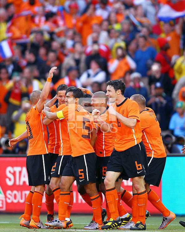 Holland players celebrates the second goal of the game against Denmark scored by Dirk Kuyt (hidden)