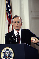 ***FILE PHOTO*** George H.W. Bush Has Passed Away<br /> Washington DC., USA, June 4, 1992<br /> President George H.W. Bush respondes to questions from reporters in the White House East Room in the second prime time news conference during his presidency. He delivered a statement in support of a balanced budget amendment, and responded to questions on several topics <br /> CAP/MPI/MRN<br /> &copy;MRN/MPI/Capital Pictures